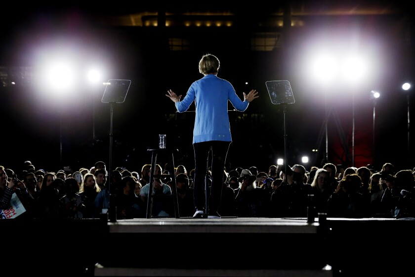 Democratic presidential candidate Sen. Elizabeth Warren, D-Mass., speaks to supporters during a town hall Thursday, Feb. 29, 2020, at Discovery Green in Houston. (AP Photo/Michael Wyke)