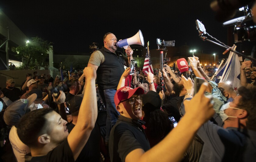 Far-right radio host and conspiracy theorist Alex Jones rallies a crowd of Trump supporters in Phoenix.