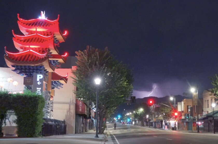 Thunder and lightning filling the sky in the Chinatown area of downtown Los Angeles on Thursday evening.