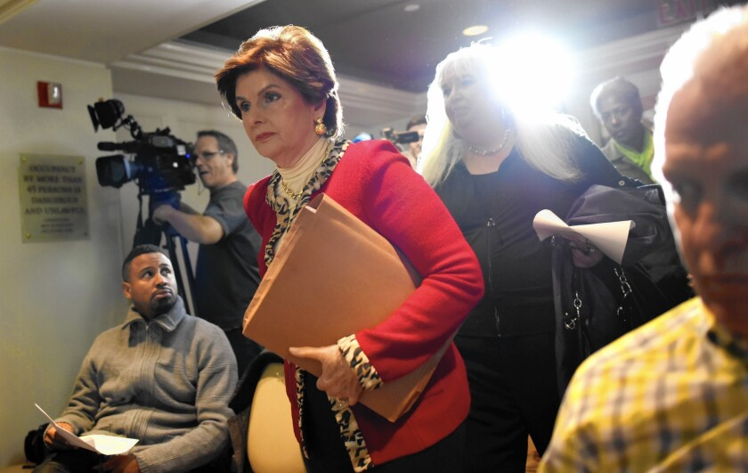 Attorney Gloria Allred walks into a New York news conference with two women who allege they were victims of sexual misconduct by comedian Bill Cosby.