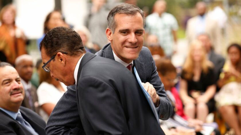 Mayor Eric Garcetti, right, gives a friendly shoulder bump to Council President Herb Wesson in 2016.