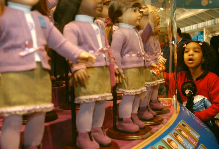 Samantha Small, 7, of Brooklyn, N.Y., looks at dolls for sale at the American Girl Place store in New York on Nov. 8, 2003.