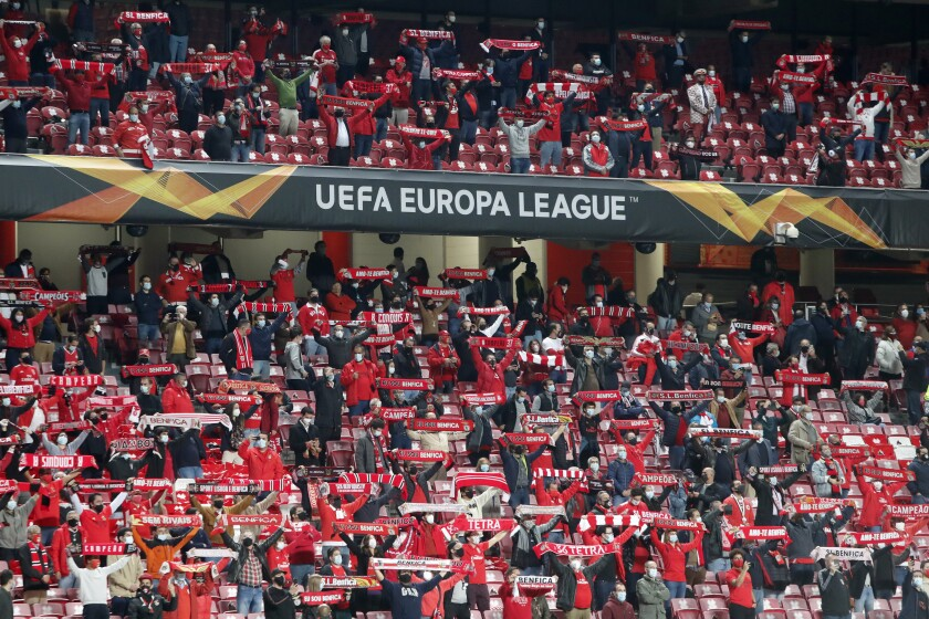 Benfica fans hold up their scarves before the start of the Europa League group D soccer match between Benfica and Standard Liege at the Luz stadium in Lisbon, Thursday, Oct. 29, 2020. (AP Photo/Armando Franca)
