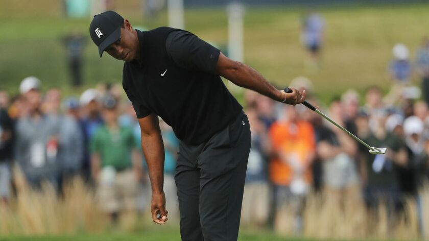 Tiger Woods reacts as he misses a putt on the 17th green during the second round of the PGA Championship on May 17.