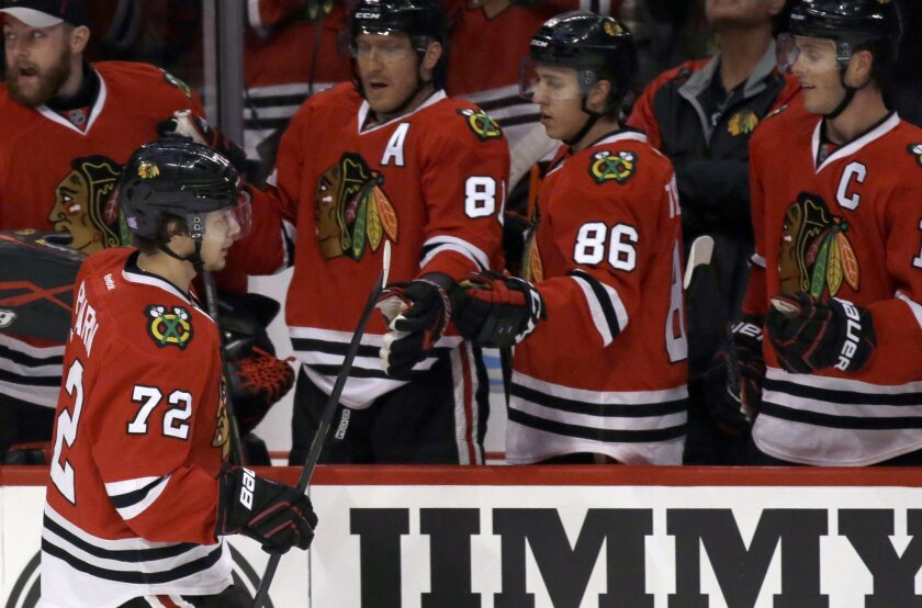 Chicago Blackhawks left wing Artemi Panarin (72) celebrates with teammates after scoring a goal during the first period of an NHL hockey game against the Edmonton Oilers, Sunday, Nov. 8, 2015,  in Chicago. (AP Photo/Nam Y. Huh)