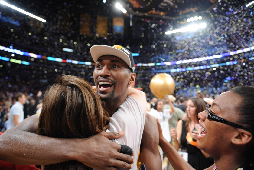 Metta World Peace, then known as Ron Artest, celerates the Lakers' win over the Boston Celtics in Game 7 of the NBA Finals on June 17, 2010.