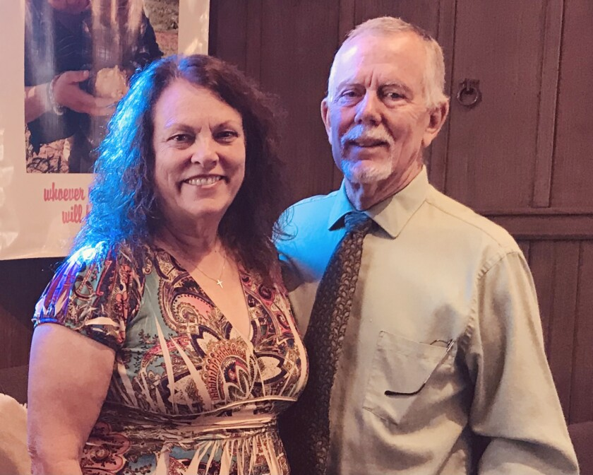 Dolores and Hal Mortier have continued community service through nearly 25 years of marriage.