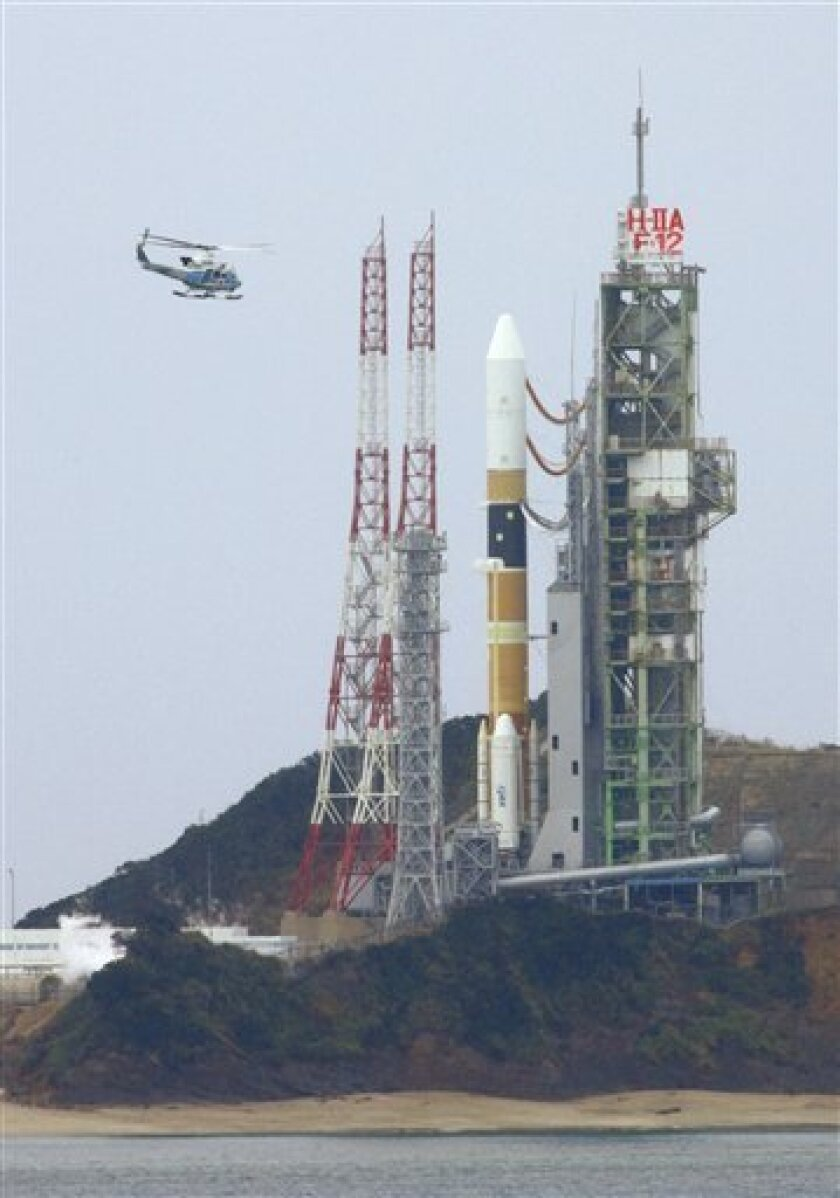 In this  Friday, Feb. 16, 2007 file photo, a chopper flies over the launching pad just about ten minutes before the scheduled launch of a Japanese spy satellite at Tanegashima Space Center. Japan got its first commercial order to launch a satellite on a home-grown rocket on Monday, a deal that Japa