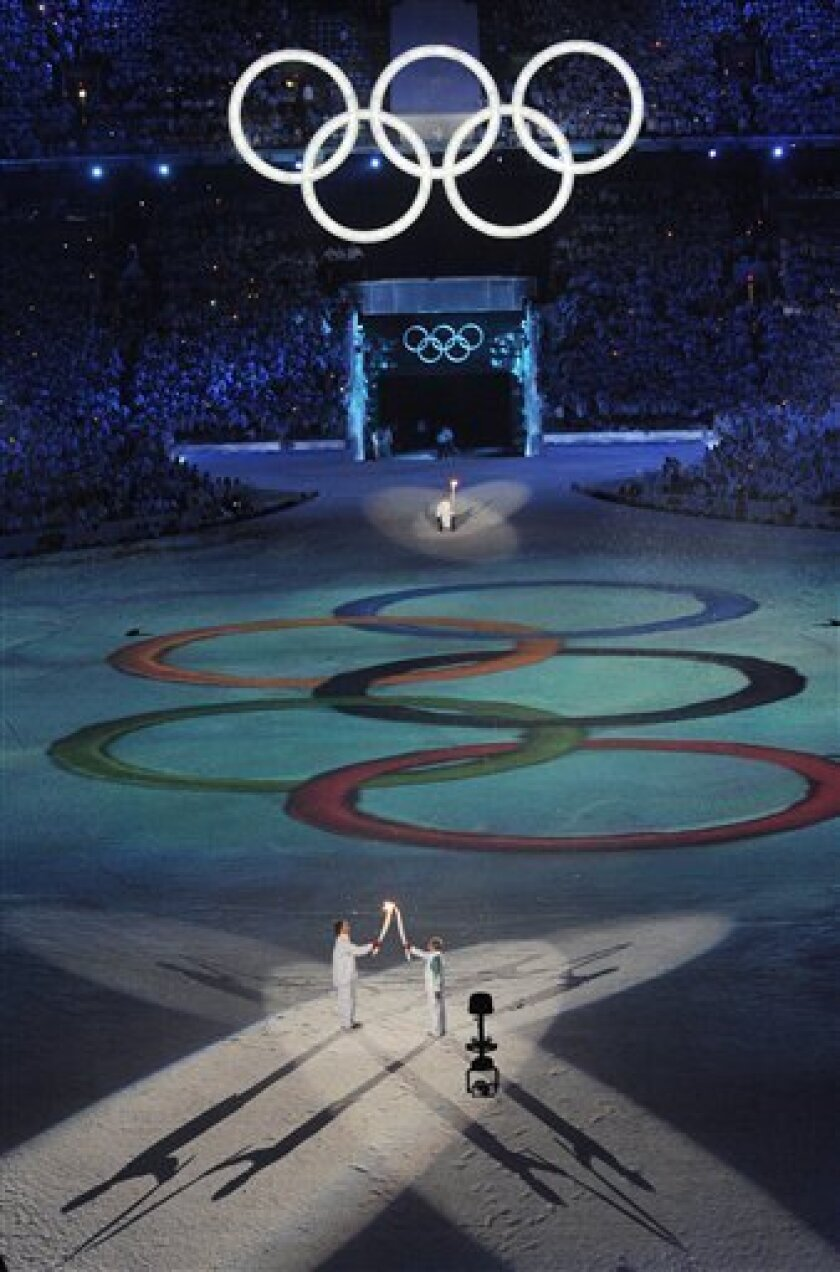 The Olympic torch is passed during the opening ceremony for the Vancouver 2010 Olympics in Vancouver, British Columbia, Friday, Feb. 12, 2010. (AP Photo/Mark J. Terrill)