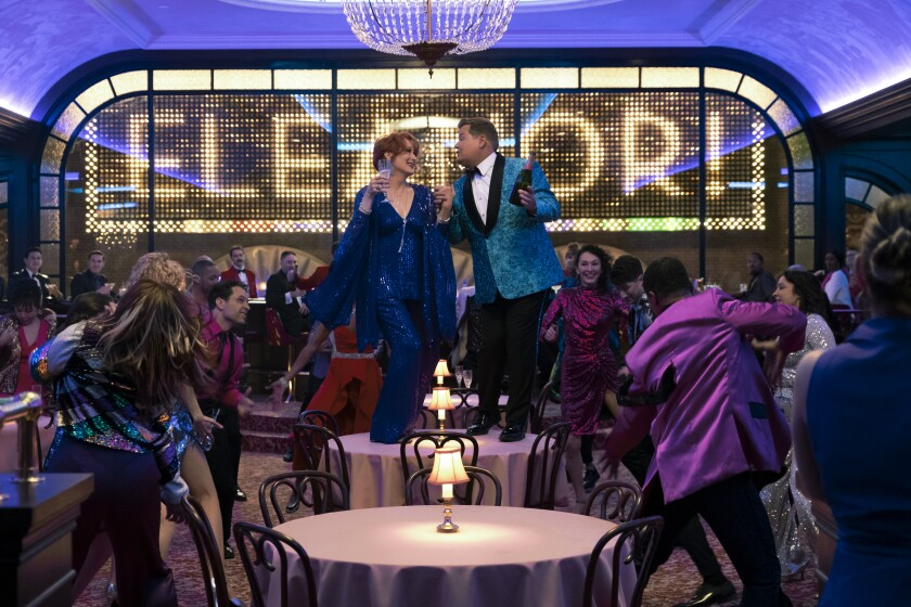 """This image released by Netflix shows, Meryl Streep, center left, and James Corden in a scene from """"The Prom."""" (Melinda Sue Gordon/Netflix via AP)"""