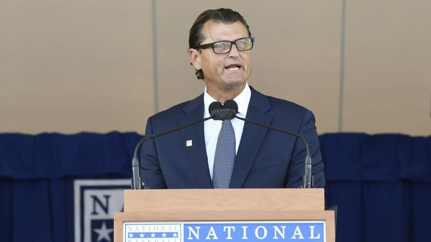 National Baseball Hall of Fame inductee Trevor Hoffman speaks during an induction ceremony at the Clark Sports Center on Sunday, July 29, 2018, in Cooperstown, N.Y.