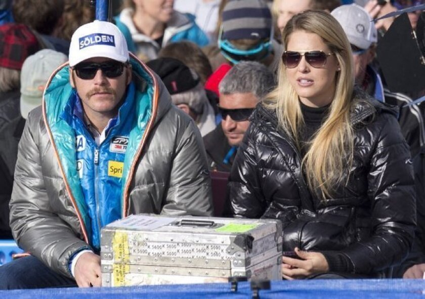 Bode Miller and his wife, Morgan, watch a skiing event on Nov. 30.