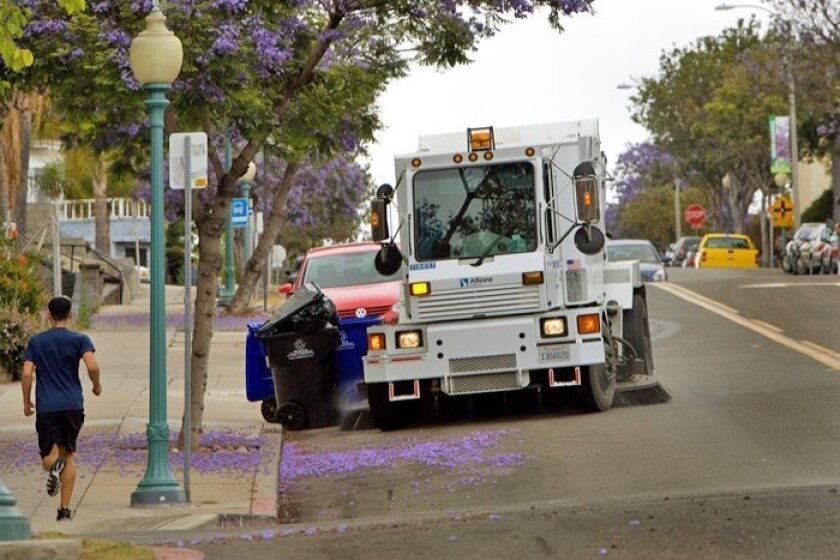Street-sweeper operator Todd Ethridge makes his way down Broadway in Golden Hill. Picking up copper dust is important to avoid having it wash down storm drains and eventually into creeks and bays.