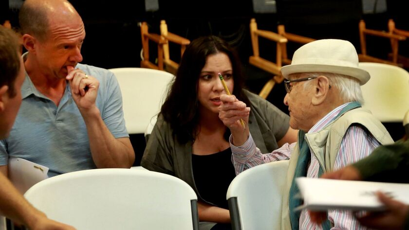 """Table read of Netflix's all-Latino update of """"One Day at a Time.""""  TV legend Norman Lear (in white hat) talks with show runners Mike Royce and Gloria Calderon Kellett."""