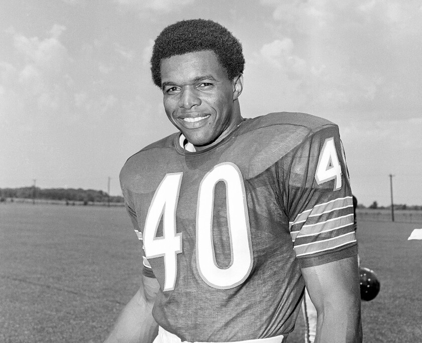 """FILE - This is a 1970 file photo showing Chicago Bears football player Gale Sayers. Hall of Famer Gale Sayers, who made his mark as one of the NFL's best all-purpose running backs and was later celebrated for his enduring friendship with Chicago Bears teammate Brian Piccolo, has died. He was 77. Nicknamed """"The Kansas Comet"""" and considered among the best open-field runners the game has ever seen, Sayers died Wednesday, Sept. 23, 2020, according to the Pro Football Hall of Fame. (AP Photo/File)"""