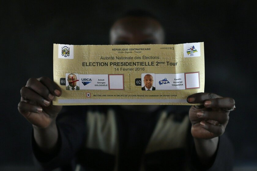 Election officials tally the ballots after polling stations closed in the second round of presidential elections in Bangui, Central African Republic, Sunday Feb. 14, 2016. Two former prime ministers, Faustin Archange Touadera and Anicet Georges Dologuele, are running neck-and-neck in the second rou