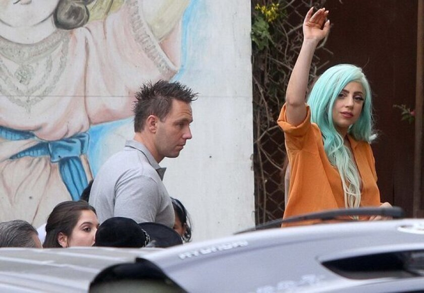 Lady Gaga waves as she visits a center for girls who are victims of sexual abuse in Lima, Peru, on Thursday. She spent the day giving food to about 45 girls at the Caritas Felices center.
