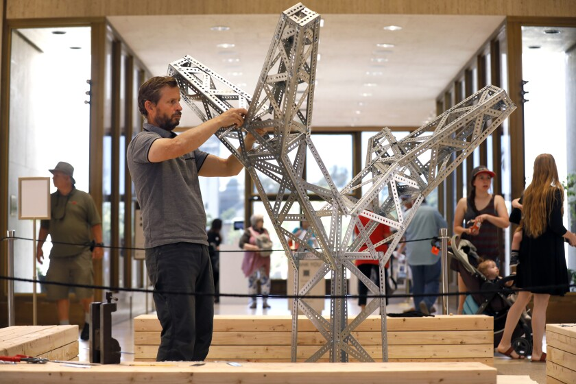 "Roman de Salvo, the artist-in-residence at the Timken Museum of Art, works on his ""Electric Picnic"" installation at the Balboa Park museum."