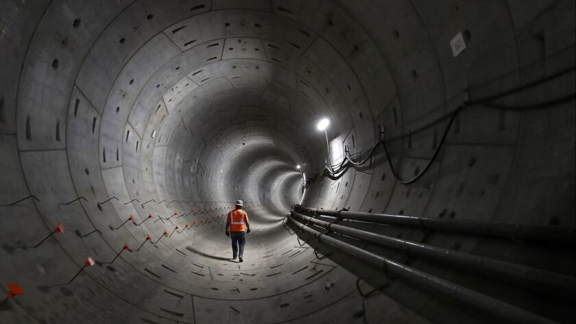 The Regional Connector, a 1.9-mile set of twin tunnels beneath downtown Los Angeles, will run from Little Tokyo to the financial district to link three rail lines, allowing for longer trips without changing trains.