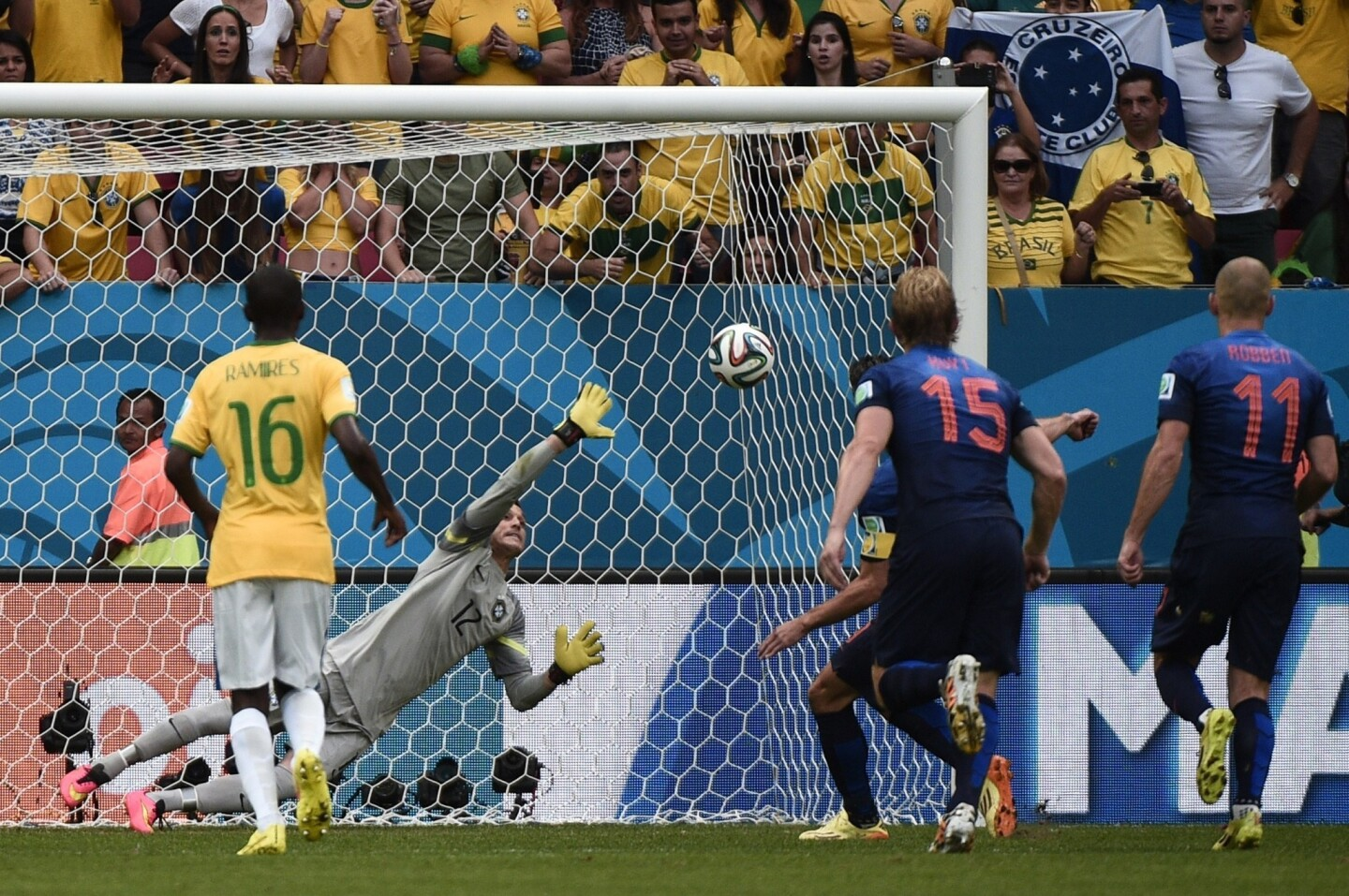 Brazil goalkeeper Julio Cesar can't stop a penalty kick by the Netherlands' Robin van Persie from finding the back of the net during the Netherlands' 3-0 win in the third-place match of the 2014 World Cup.