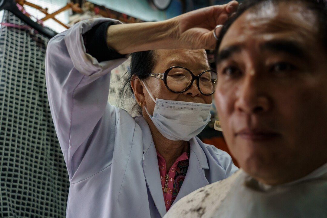 Lee Duk-hoon at work at her Seoul barbershop
