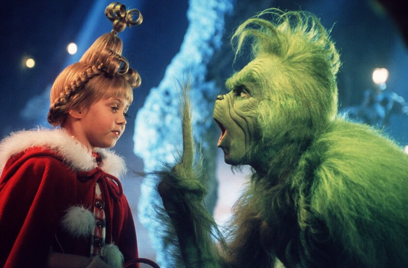 """Taylor Momsen as Cindy Lou Who, left, shares a scene with the Grinch, played by Jim Carrey in a scene from """"Dr. Seuss' How The Grinch Stole Christmas."""""""