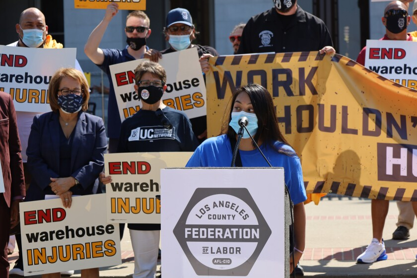 Former Amazon warehouse worker Yesenia Barrera rallies for injury protections.