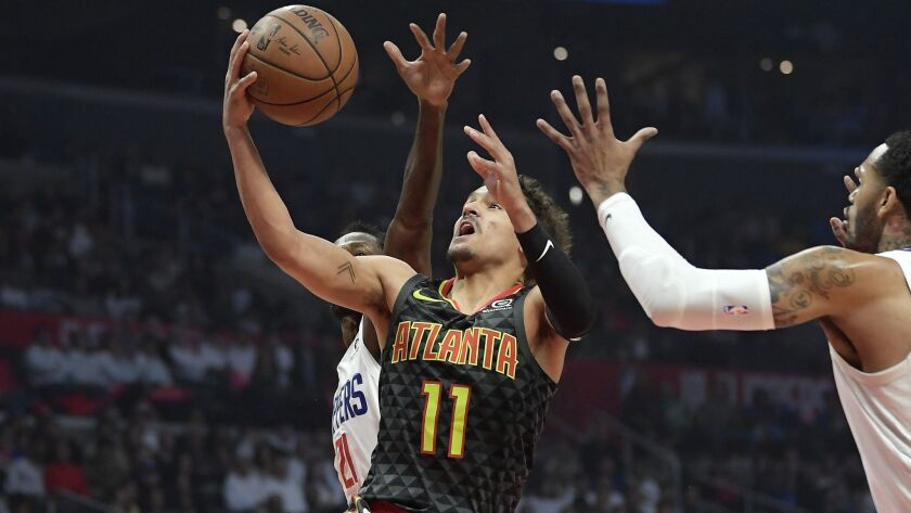 Atlanta guard Trae Young drives to the basket against Clippers, who guard Avery Bradley says took a step back defensively in a 123-118 loss to the Hawks on Monday.
