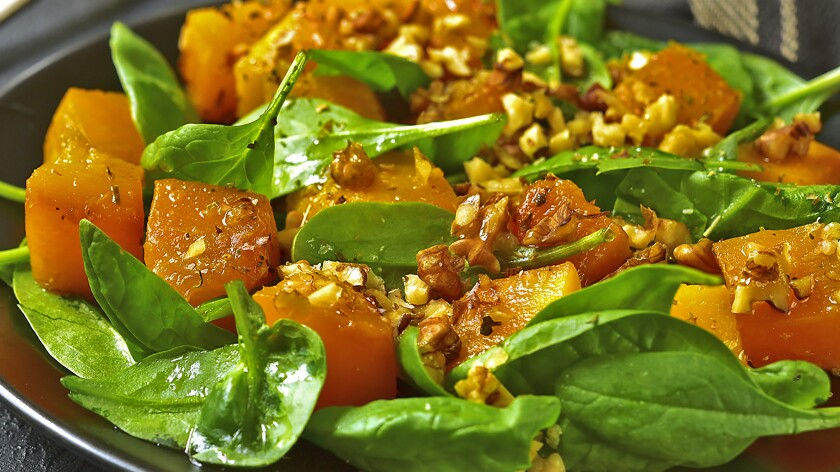 Warm Winter Spinach and Butternut Squash Salad with Chopped Nuts