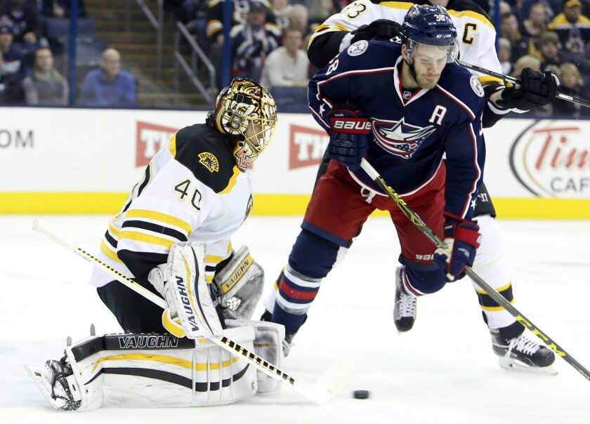 Boston Bruins' Tuukka Rask, left, of Finland, makes a save against Columbus Blue Jackets' Boone Jenner during the second period of an NHL hockey game Tuesday, Feb. 16, 2016, in Columbus, Ohio. (AP Photo/Jay LaPrete)