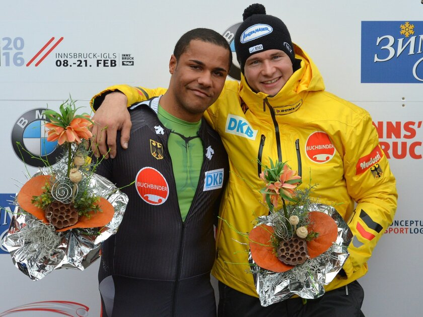Germany's second placed Johannes Lochner, right, and Joshua Bluhm    pose for media after  the two-man bob race at the Bob World Championships  in Igls, near Innsbruck, Austria, on Sunday, Feb. 14, 2016. (AP Photo/Kerstin Joensson)