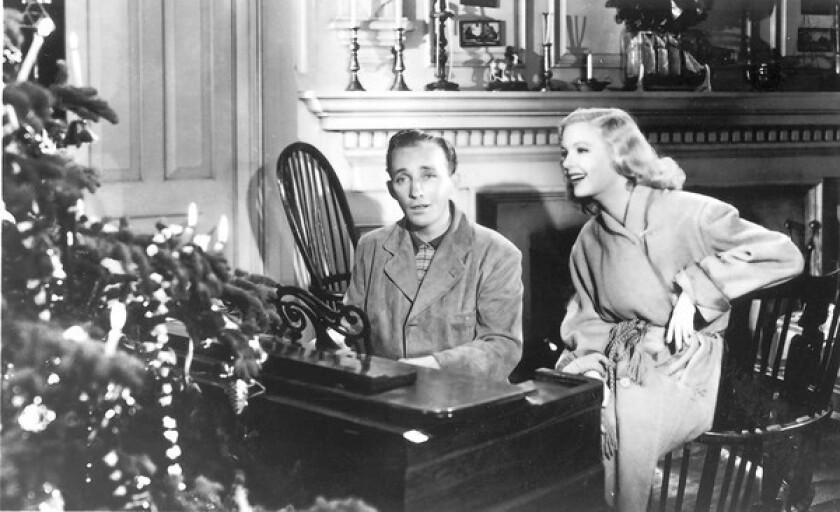 """Bing Crosby and Marjorie Reynolds in the Christmas classic, """"Holiday Inn."""""""