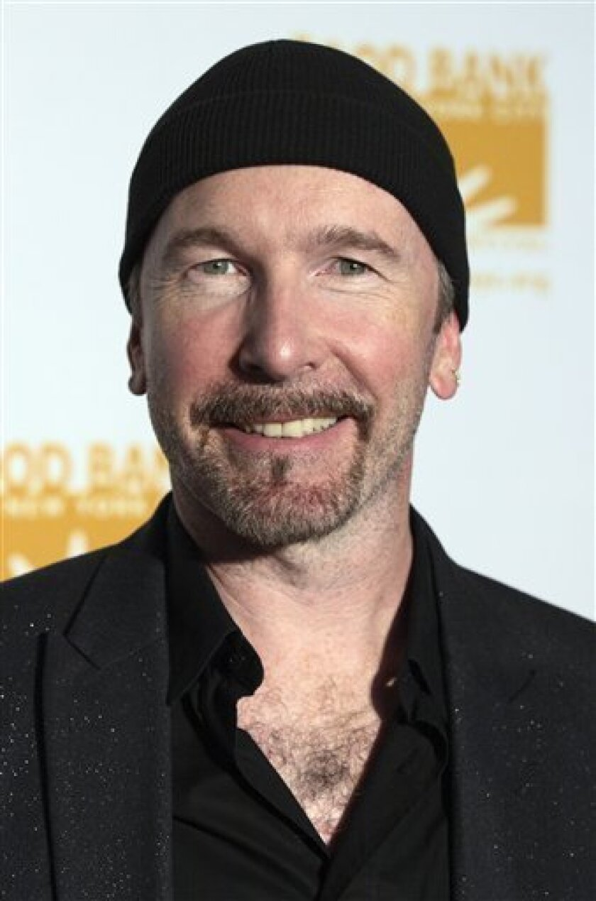 FILE - In this Monday, April 23, 2007 file photo, U2 guitarist The Edge is pictured in New York. Through his spokespeople, The Edge, whose real name is David Evans, says the half dozen mansions he wants to build will look like fallen leaves on a hillside and have about as much impact on the surrounding environment. (AP Photo/Adam Rountree, file)