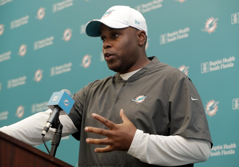 FILE - In this April 17, 2019, file photo, Miami Dolphins general manager Chris Grier speaks during a news conference during voluntary minicamp at the Miami Dolphins NFL football training facility, in Davie, Fla. Grier says this year's roster dismantling has been more drastic than he expected, but a turnaround can come quickly because the team will be aggressive in free agency in 2020. (AP Photo/Lynne Sladky, File)