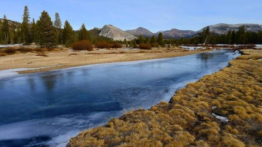 The Tuolumne River in Yosemite National Park on Jan. 3, 2012, reveals a landscape usually frozen and covered with snow at that time of year. Several evidences of climate change that state scientiests cited were from the Sierra Nevada, including reduced spring runoff.