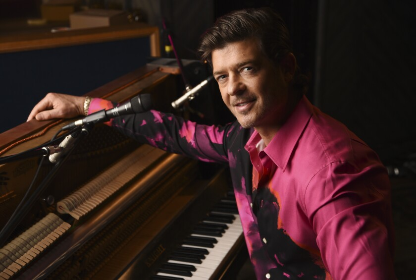 """Singer/songwriter Robin Thicke poses for a portrait at Gold Diggers Sound in Los Angeles on Feb. 3, 2021 to promote his eighth album """"On Earth, and In Heaven."""" (AP Photo/Chris Pizzello)"""