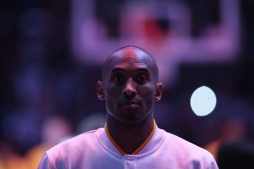 Kobe Bryant stands for the national anthem before a game.