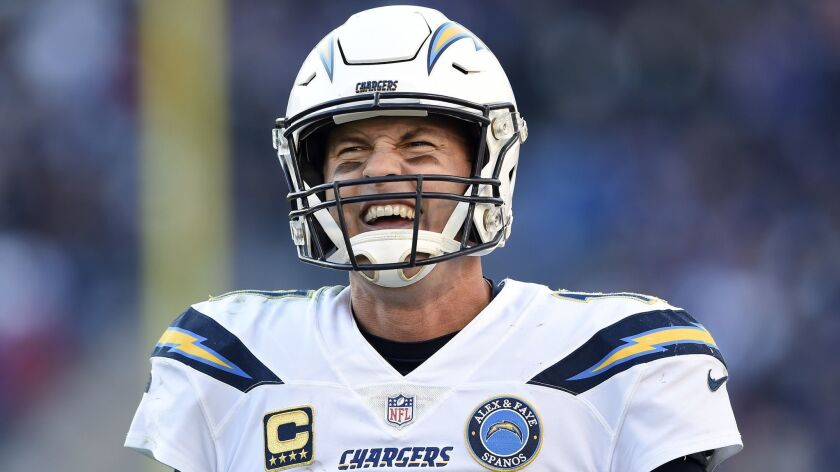 Los Angeles Chargers quarterback Philip Rivers walks on the field in the second half of an NFL wild