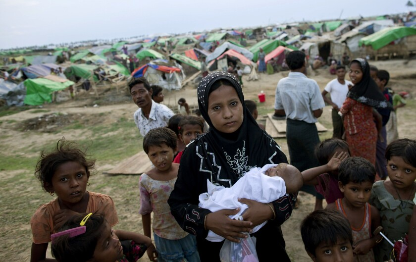 A Rohingya woman shown in this May 2013 photo holds her newborn baby at a makeshift camp for the stateless Muslims in Sittwe, in northwestern Rakhine state. The region has been afflicted with sectarian violence for nearly two years, the latest incident taking more than 40 Rohingya lives earlier this month, the United Nations has reported.