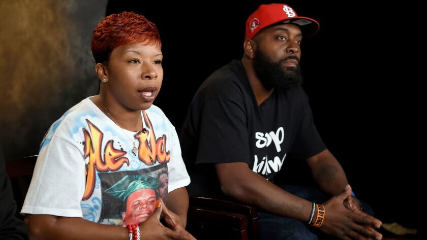 FILE - In this Sept. 27, 2014, file photo, the parents of Michael Brown, Lezley McSpadden, left, and