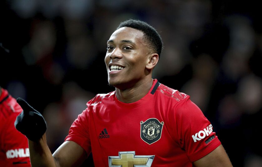 Manchester United's Anthony Martial celebrates scoring during the English Premier League soccer match between Manchester United and Norwich City at Old Trafford, Manchester, England, Saturday Jan. 11, 2020. (Martin Rickett/PA via AP)