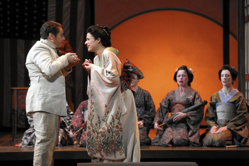 """Stefano Secco, left, plays the American naval officer Benjamin Franklin Pinkerton and Ana Maria Martinez stars as the title character in L.A. Opera's production of """"Madame Butterfly"""" at Dorothy Chandler Pavilion."""
