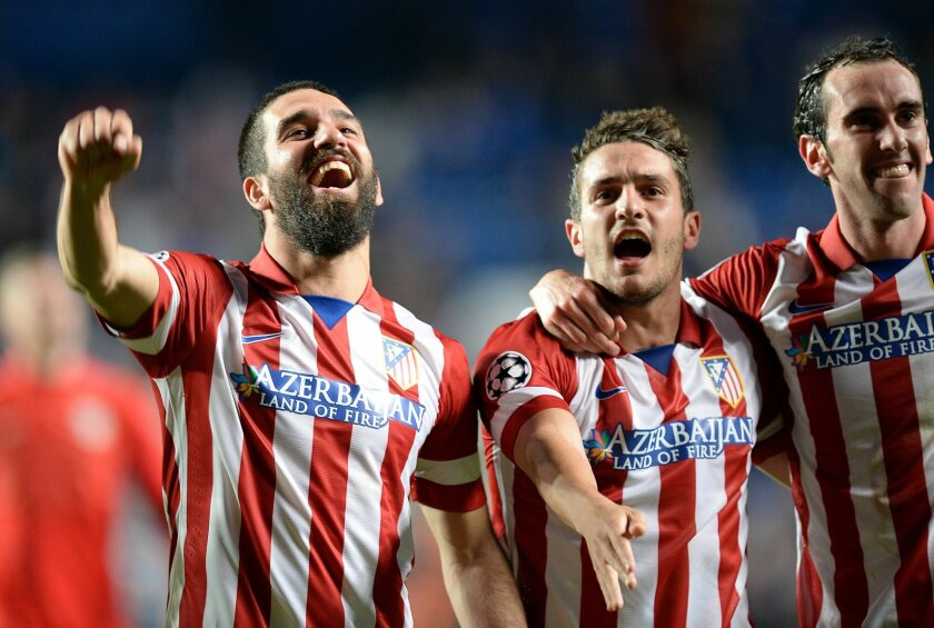 Atletico Madrid's Arda Turan, left, Koke, center, and Diego Godin celebrate after the Champions League semifinal second leg soccer match between Chelsea and Atletico Madrid at Stamford Bridge Stadium in London, Wednesday, April 30, 2014. (AP Photo/Andrew Matthews, PA Wire)    UNITED KINGDOM OUT   -