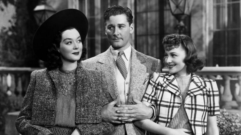 Famous rogue Errol Flynn (with Rosalind Russell and Olivia de Havilland) went to a fundraiser for th