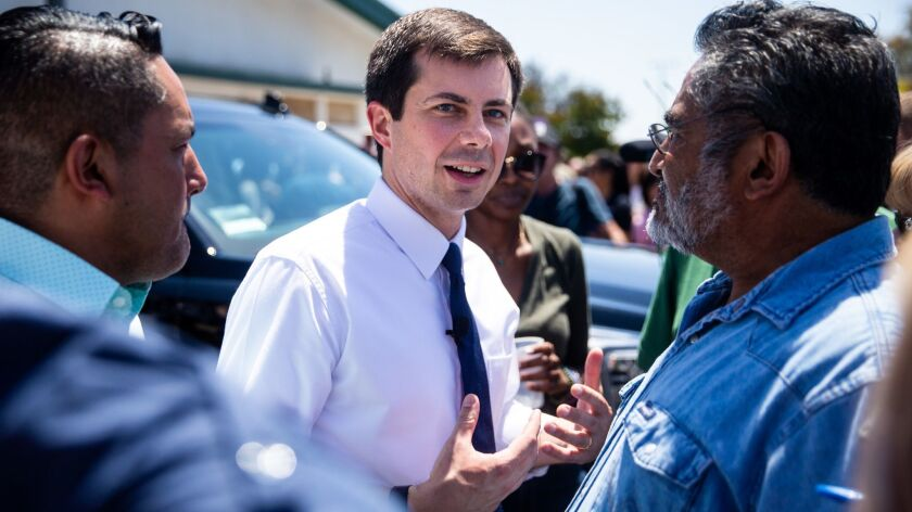 Democratic presidential candidate Pete Buttigieg speaks with Humberto M. Gomez after an event in Fresno.
