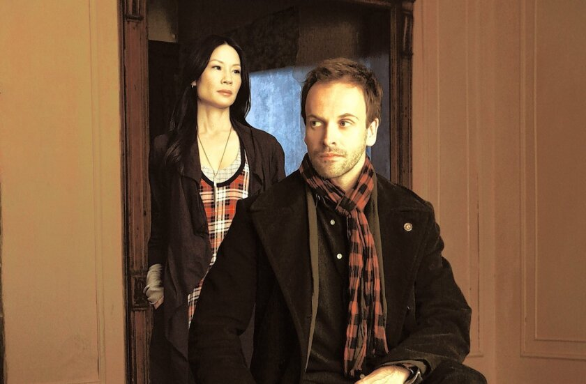 """""""Elementary"""" stars Jonny Lee Miller as detective Sherlock  Holmes and Lucy Liu as Dr. Joan Watson in a modern-day drama about a crime-solving duo that cracks the NYPD's most impossible   cases."""