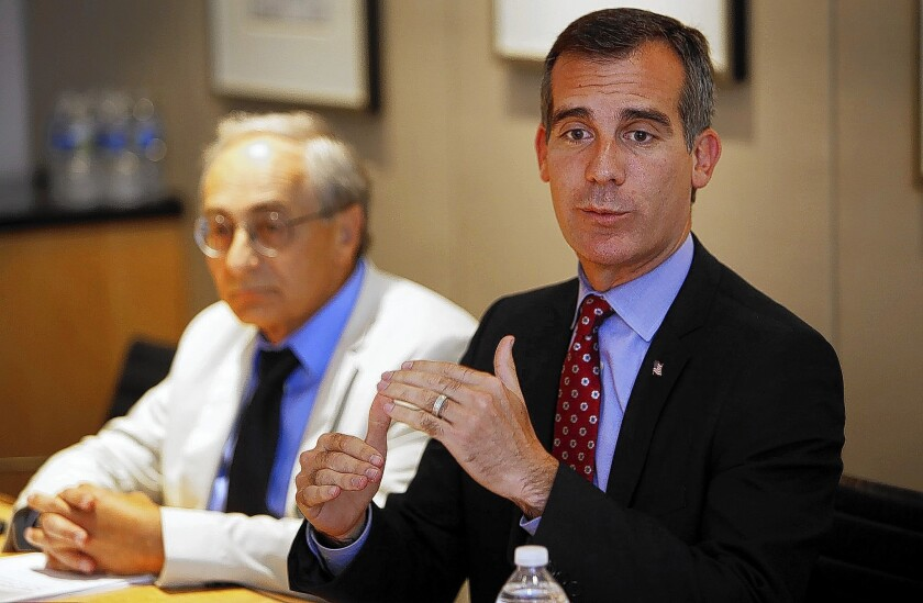 Los Angeles Mayor Eric Garcetti, right, and Michael Reich, an economist, meet with The Times editorial board.