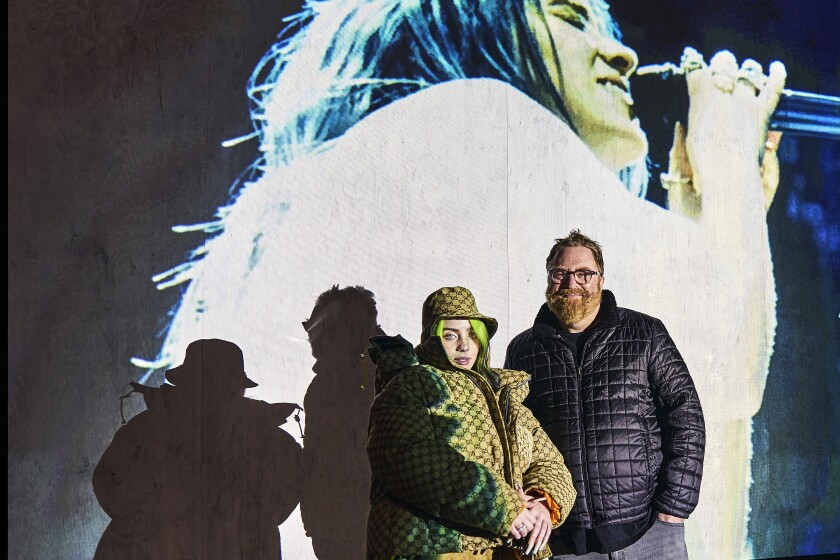 "Billie Eilish and filmmaker R. J. Cutler at the premiere of ""Billie Eilish: The World's A Little Blurry."""