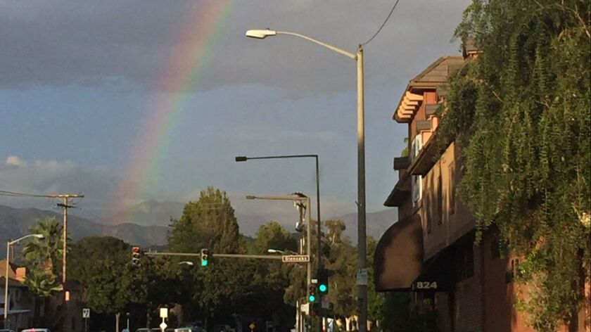 A rainbow crosses the sky in Glendale looking north from Verdugo Rd. after slight showers on Wednesd