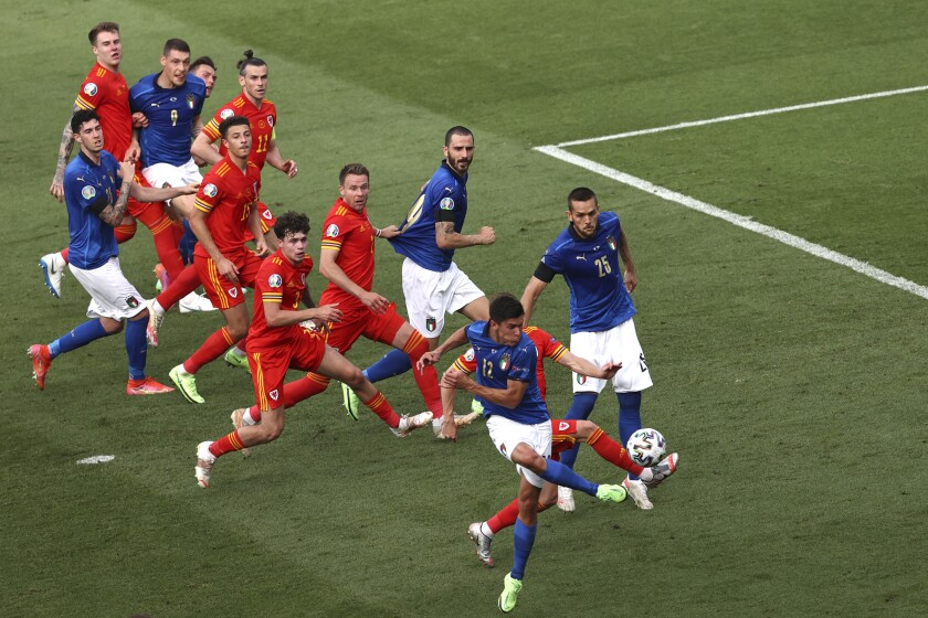 Italy's Matteo Pessina, foreground, scores his side's opening goal during the Euro 2020 soccer championship group A match between Italy and Wales at the Stadio Olimpico stadium in Rome, Sunday, June 20, 2021. (Ryan Pierse/Pool via AP)